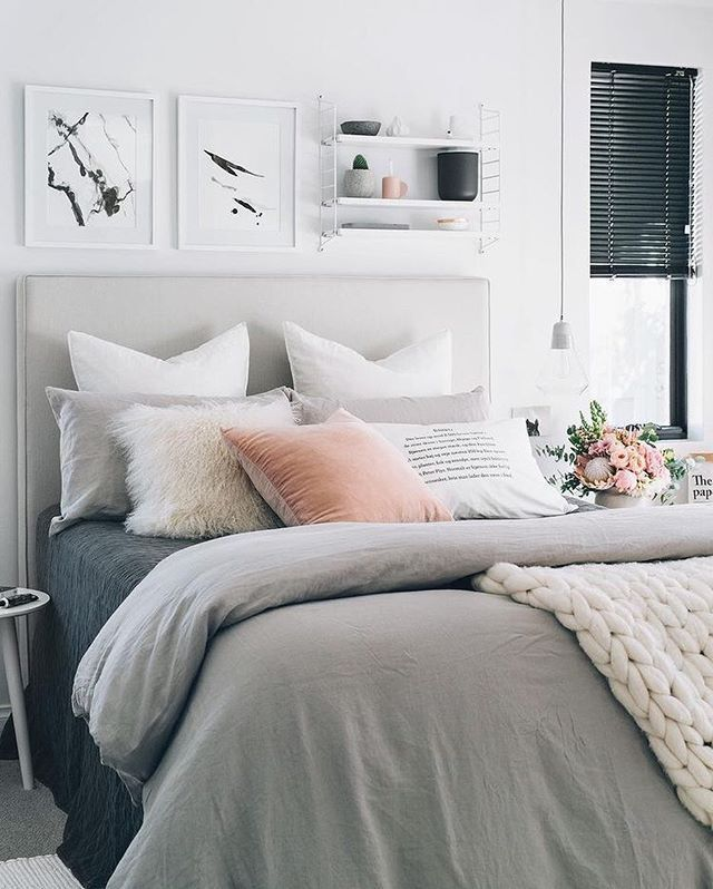 gray and white bedroom with peach accent, pantone blooming dahlia ...