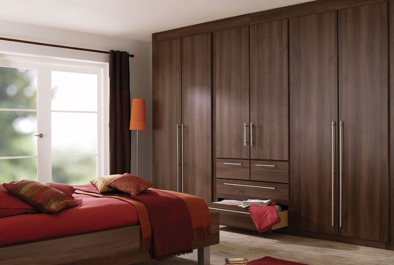 Dark brown bedroom furniture with red accessories for Dark brown bedroom designs