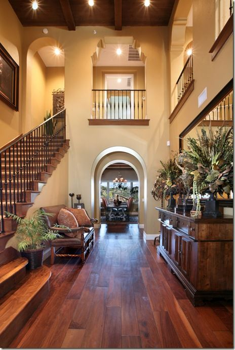 Entrance Foyer Circulation And Balcony In A House : Lovely warm entrance with open parts above to look like