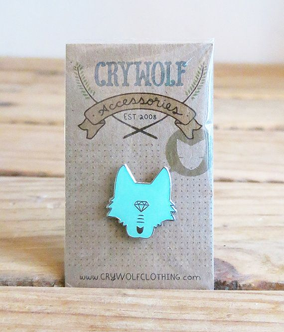 Our stoic wolf head, now in lapel pin form. This gold plated pin is stamped with the crywolf logo in the back. Size measures approx 1