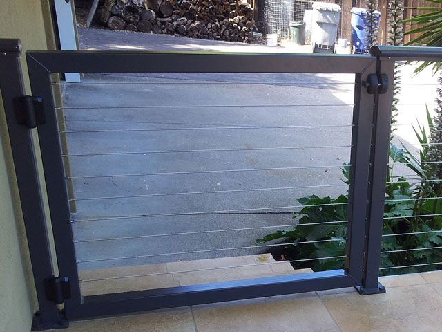 Fence and gate system made with black aluminum framing and cable ...