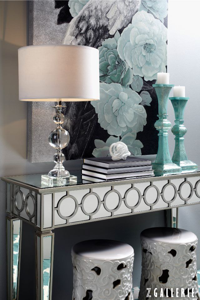 Glamorous Entry With A Mirrored Console Table, Crystal Lamp, And Aqua  Accents