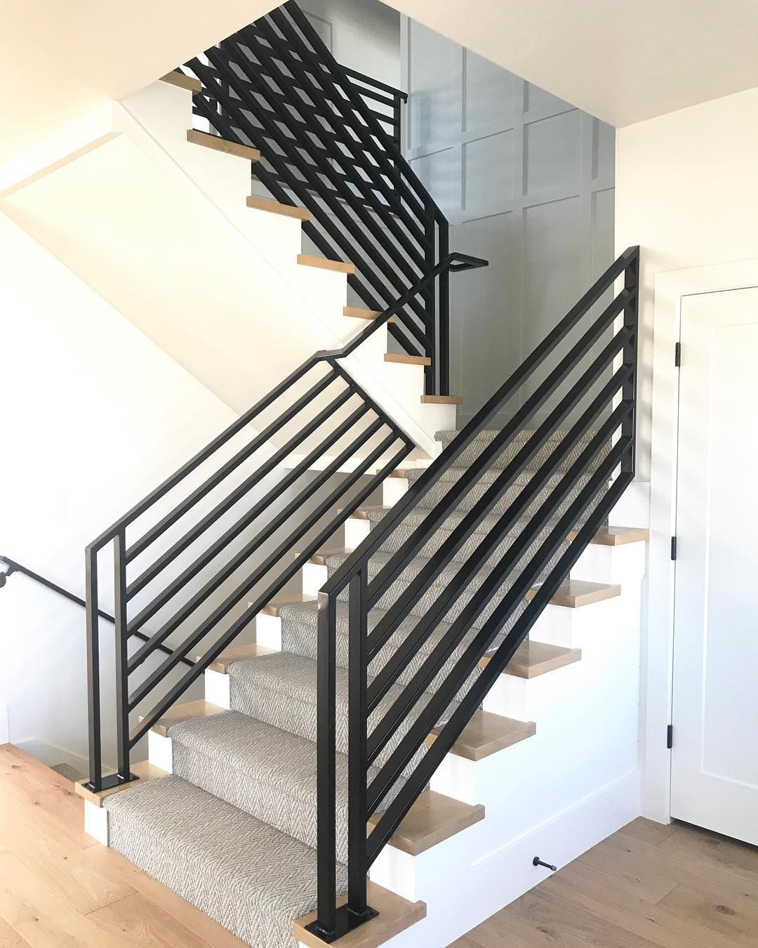 Modern Farmhouse Stairwell With Iron Railing