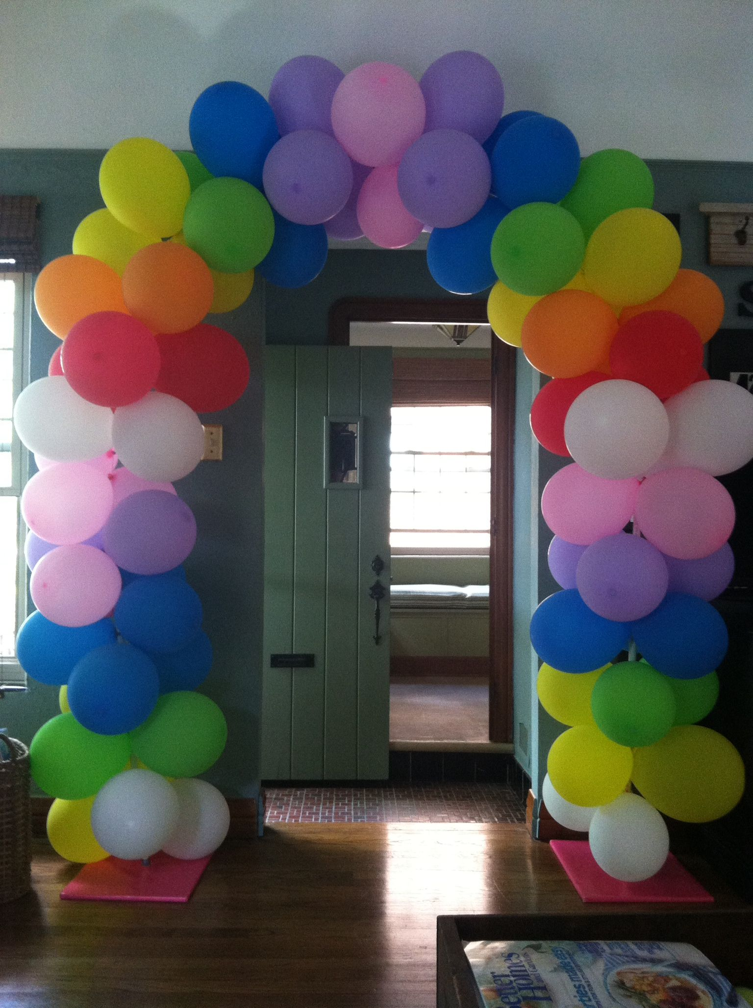 Rainbow balloon arch made w wrapping paper wrapped for How to make a rainbow arch