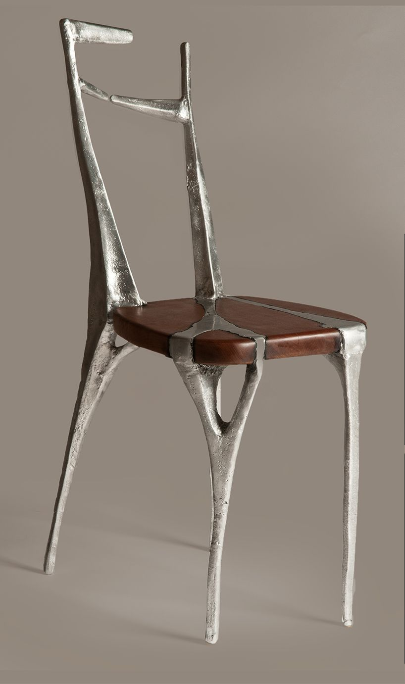 A Chair Made Of Cast Aluminium And Fine Mahogany Wood.one Piece   No Screws