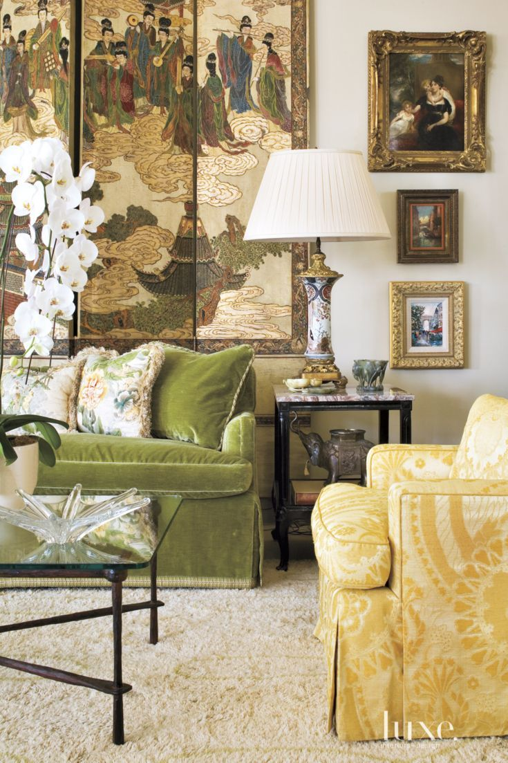 The antique Chinese Coromandel screen behind the sofa in the great room was repurposed from what used to be doors leading into the dining room at the wife's former house. The existing sofa and chair were re-covered in velvet by Gretchen Bellinger and yellow damask by Scalamandré respectively.