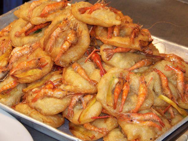 via www.mountainadventures.com Fried snacks. Old Quarter, Hanoi, Vietnam