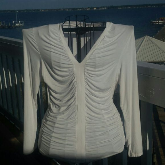 Cream color soft  knit top. CLASSIC WITH PEARLS. Cream with rosching on front. Long sleeve very Flatering bust line. Tops Tunics