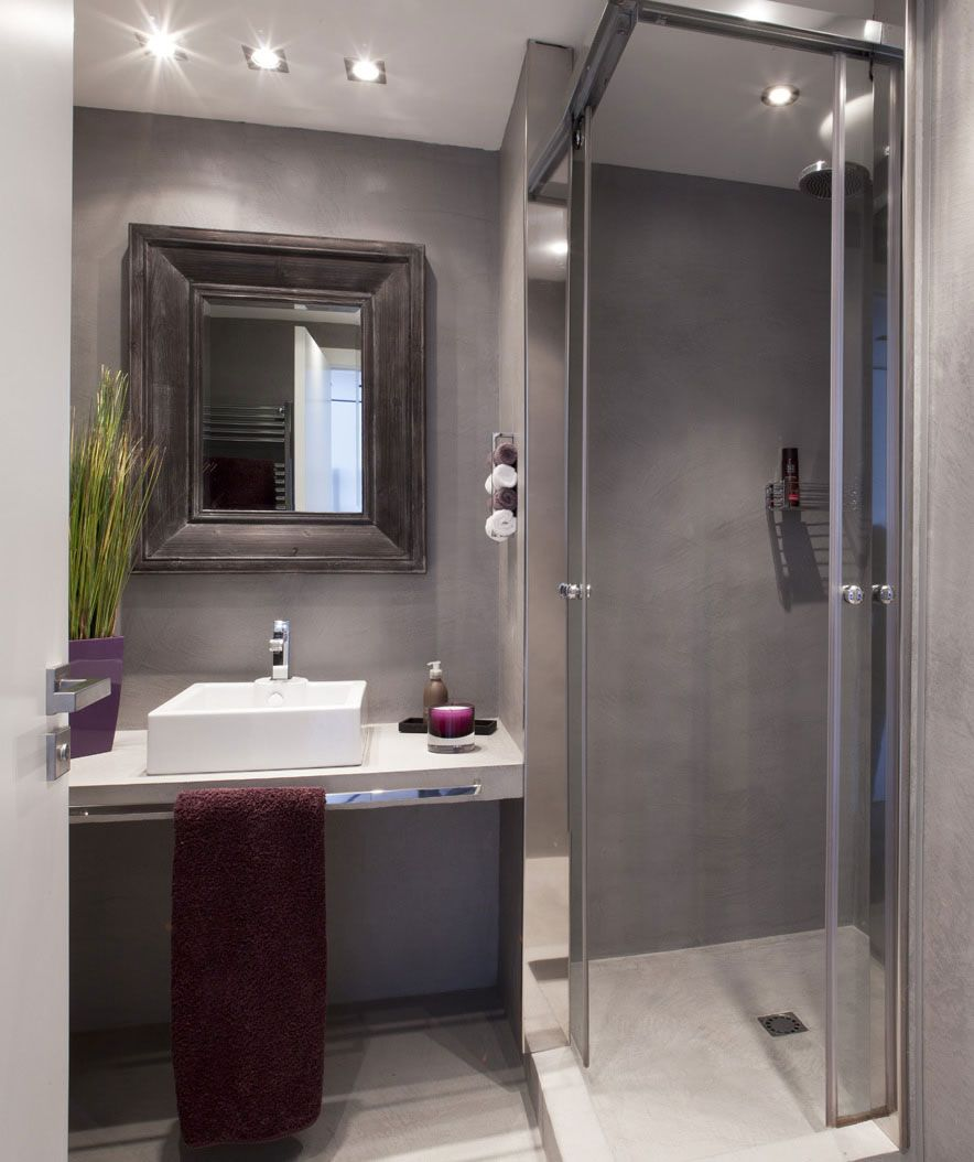 Small bathroom shower has double opening sliding doors that move