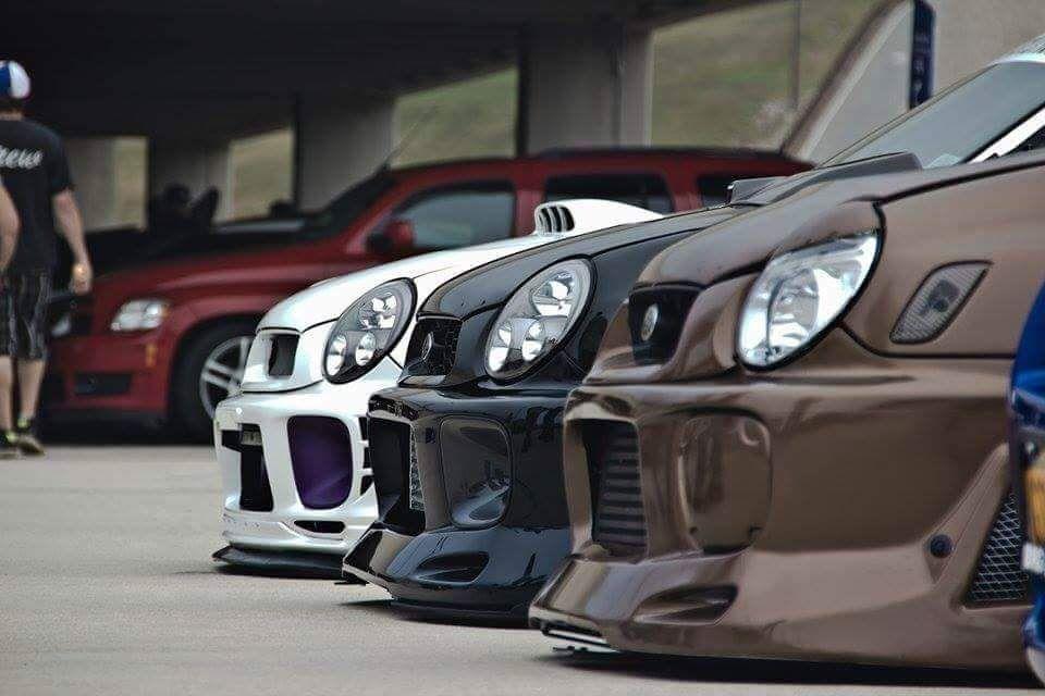 Bon Subaru WRX. LOVING THAT BROWN ONE IN FRONT!