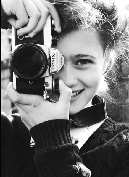 young woman and her Nixon camera