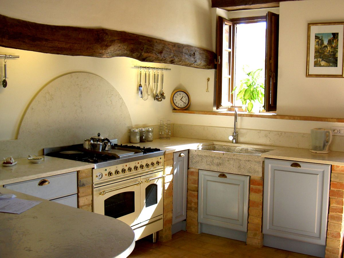 This kitchen is so sunny and warm and rustic. I could ...