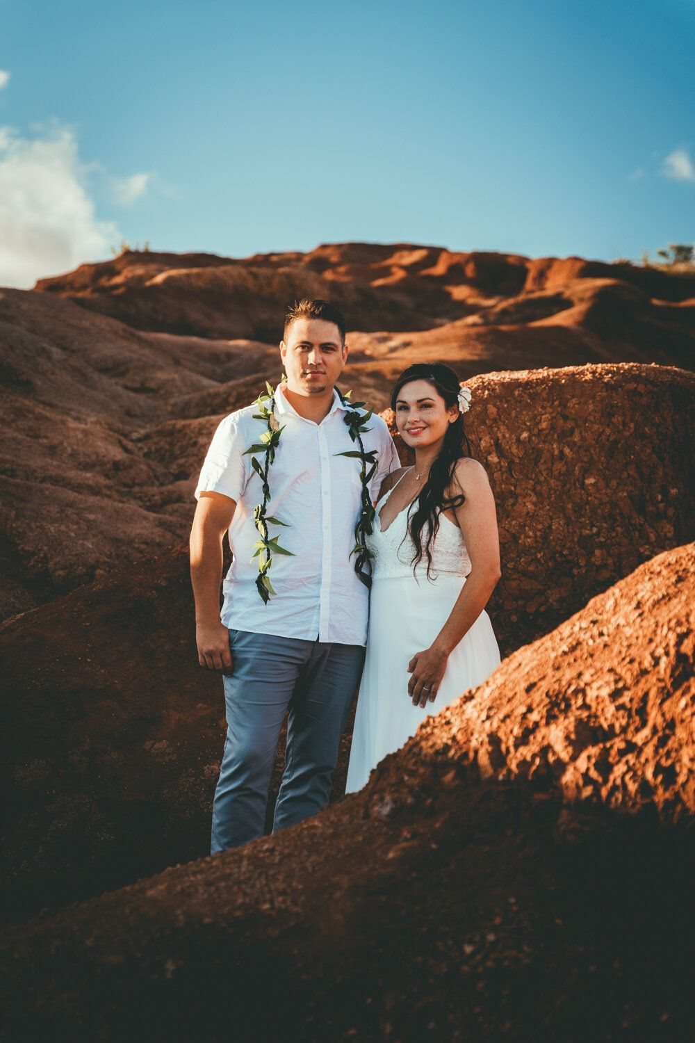 Waimea Canyon photography Kauai Hawaii. Perfect location for a couple photo shoot or elopement for a look very different than the rest of the island. Great chic photo inspiration for couples looking to elope in Kauai or in Hawaii. Booka Hawaii elopement or couple session with Ikaika Photography available at ikaika.photo. Romance, romantic, weddings, elopement, intimate weddings, engagement, proposal, love, amore, Kauai, Oahu, Maui, Big Island, Kauai weddings, Hawaii weddings, Hawaii Elopements