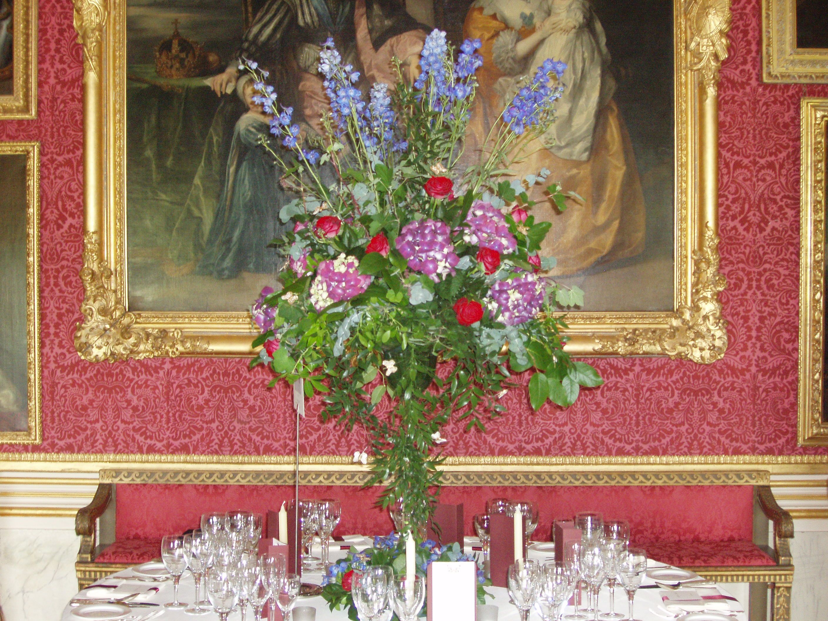 Goodwood - The Ballroom - tables decorated with tall martini vases filled with flowers