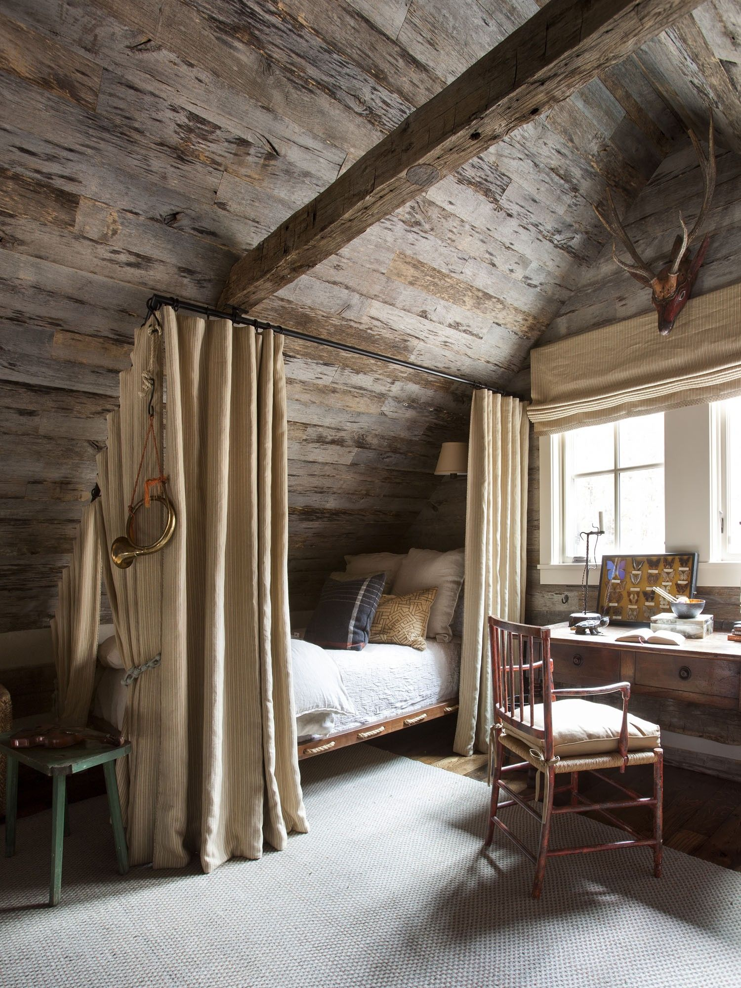 Curtains around a bed on a slope