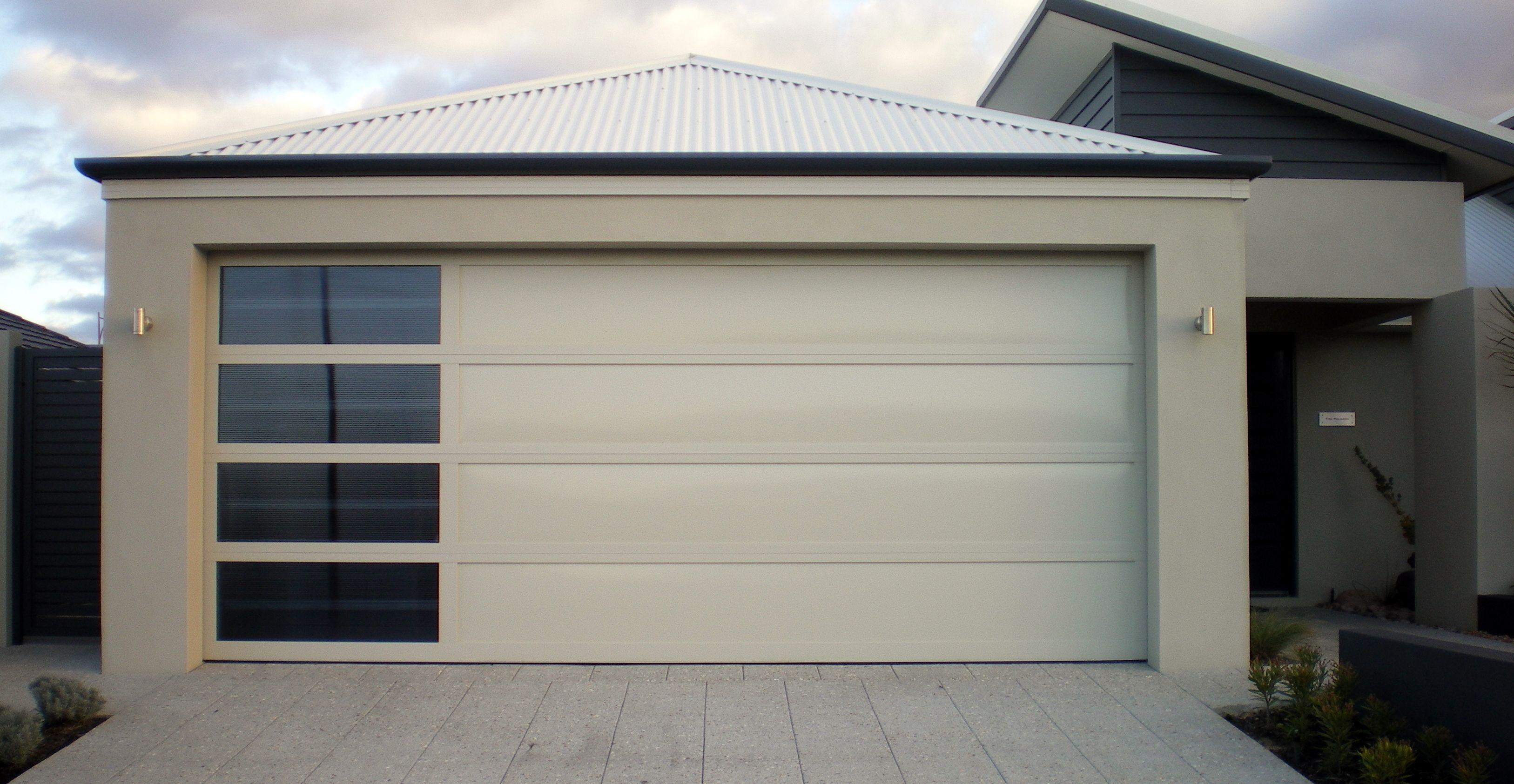 Aluminium Frame Aluminium Inserts And Sidelight Windows For A Look That S Appropriate To Mid Century Modern Garage Doors Garage Door Design Garage Door Cost