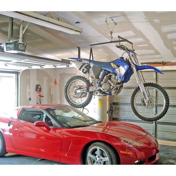 Corvette Underneath A Motocross Bike On The Hoist A Bike Hoist A Bike Bike Storage Garage Dirt Bike Shop Garage Lift