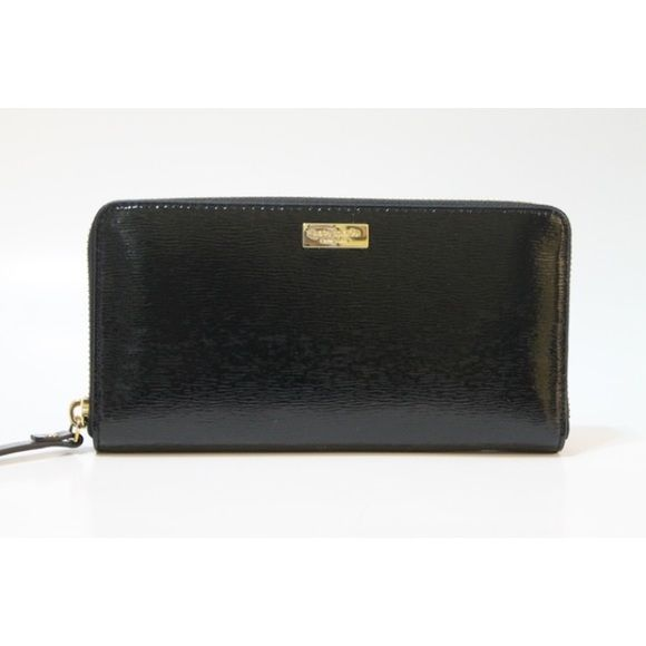 """Kate Spade Neda Bixby Place Zip Around Continental Kate Spade New York Neda Bixby Place Zip Around Continental Wallet  100% Authentic   Color: Black(001) Style: WLRU2365 Retail $145.00  Product Features Interior features 12 credit card slots, two bill pockets and zippered coin pocket Back features large exterior slip pocket Gold tone hardware details Zip around closure KS logo on front Approx Measure 8"""" X 4"""" X 0.75"""" kate spade Bags Wallets"""