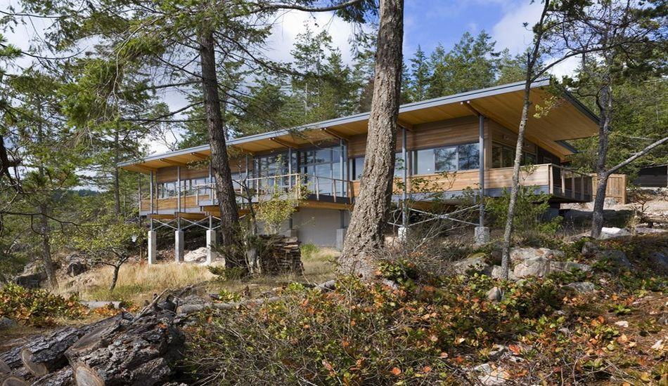 Superbe maison en bois sur pilotis avec vue imprenable sur le fleuve