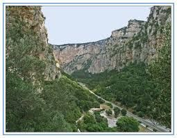 Gorge of Kleisoura: A large impressive gorge crossing Arakynthos. Impressive vertical cliffs, 300m high, rise on its slopes. Today it is driven through by the National Road Antirrio – Ioannina. A bluff trail climbs on the cliffs, which is accessible today and leads through the canyon higher, to the plateau of Arakynthos, the settlements Kato Ampelia and Ellinika. Etoloakarnania Prefecture, west Greece #ioannina-grecce Gorge of Kleisoura: A large impressive gorge crossing Arakynthos. Impressive #ioannina-grecce