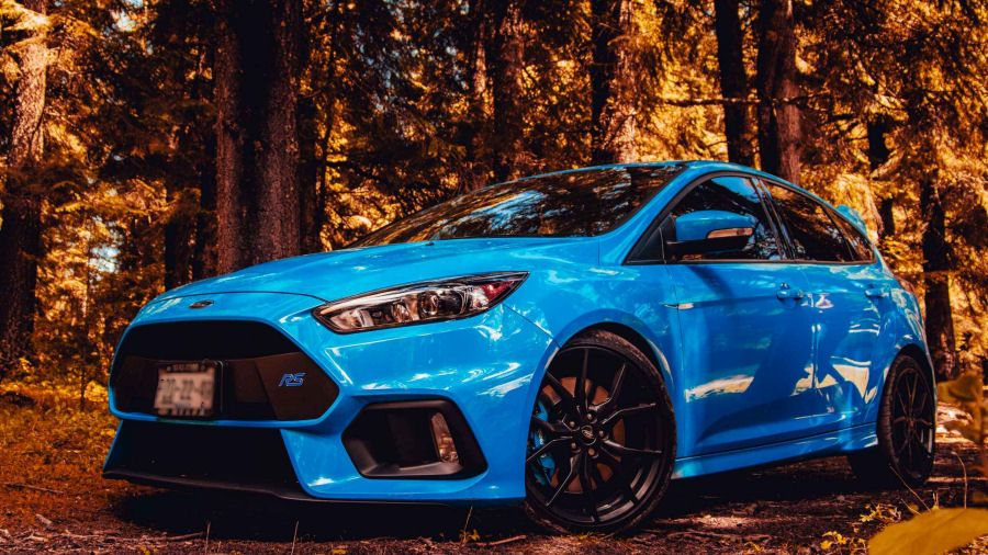 A Blue Ford Focus Rs In The Forest Ford Focus Focus Rs Ford