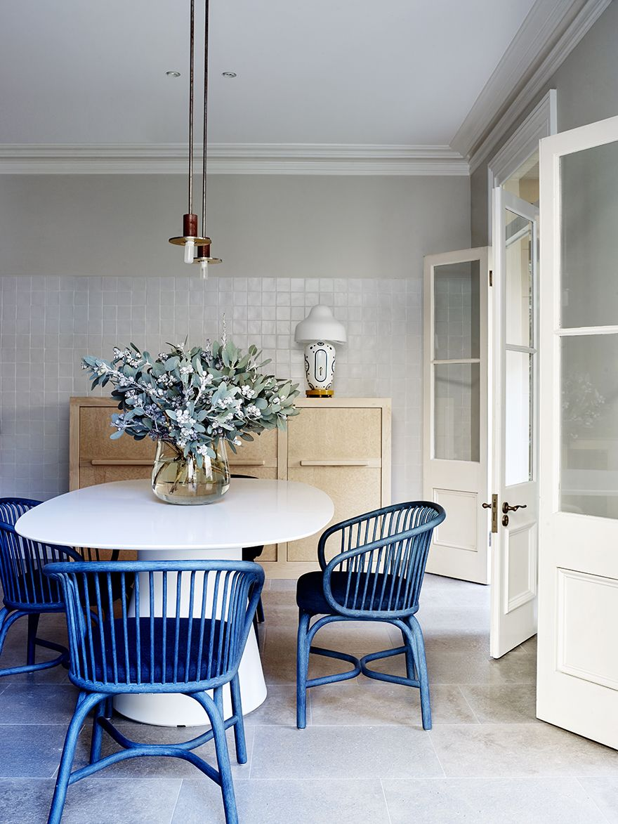 Sjb projects a private residence blue chairs colorful chairs australian interior design