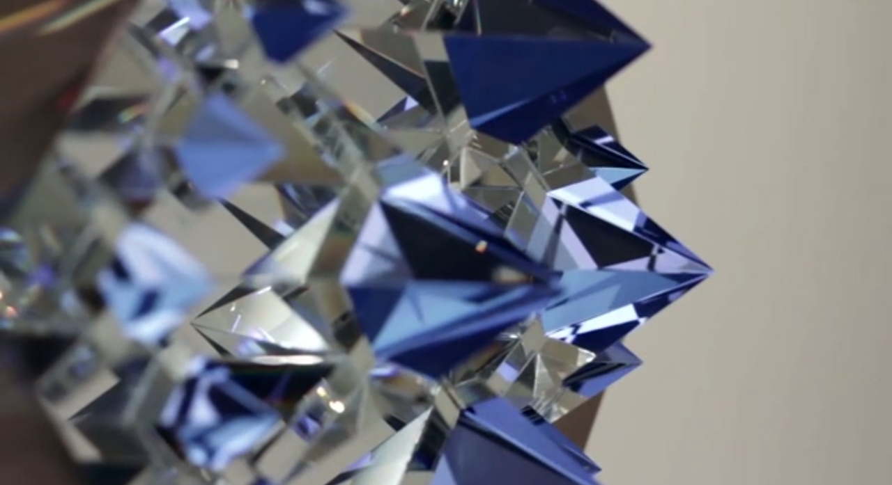 - Prismatica -   consists of an arrangement of pyramid-shaped crystals affixed to an LCD screen and illuminated with programmed geometric animation.