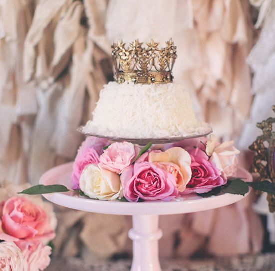 gold crown-topped, white frosted cake with rose accents