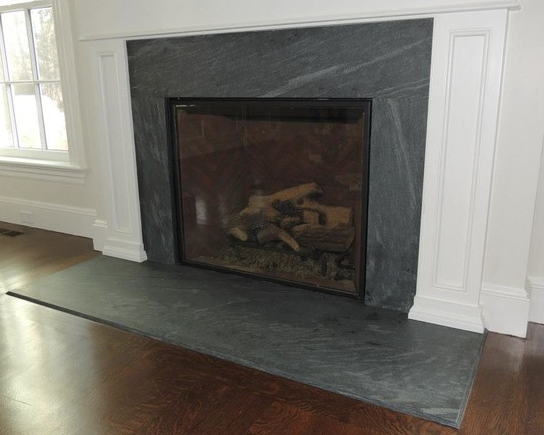 Fireplace Surrounds Make A Statement Without Saying A Word Granite Fireplace Marble Fireplace Surround Fireplace Tile