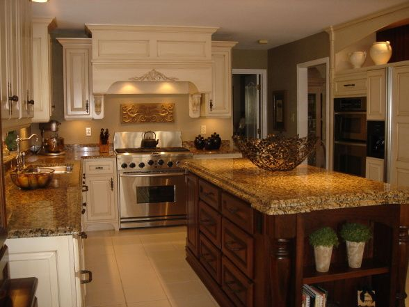 HGTV RMS Inspiration Room - my new kitchen photos. Love the rich color of the island against all the off white. Great details!