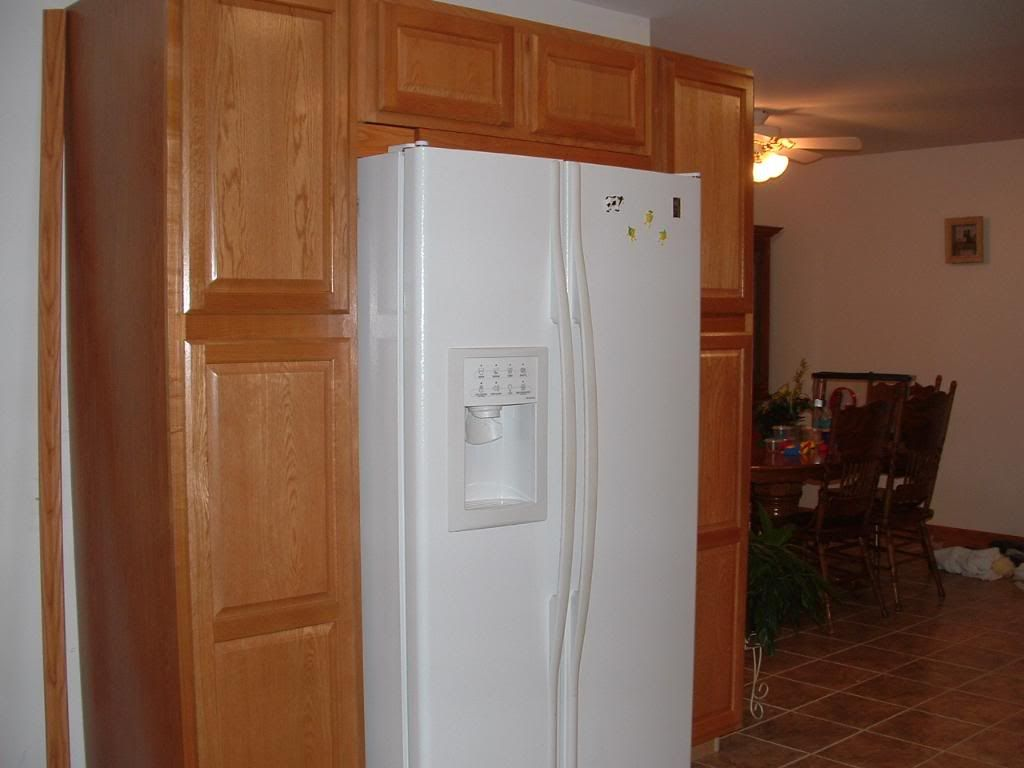 Cabinets build around a white refrigerator. (DONT LIKE THE FRIDGE ...