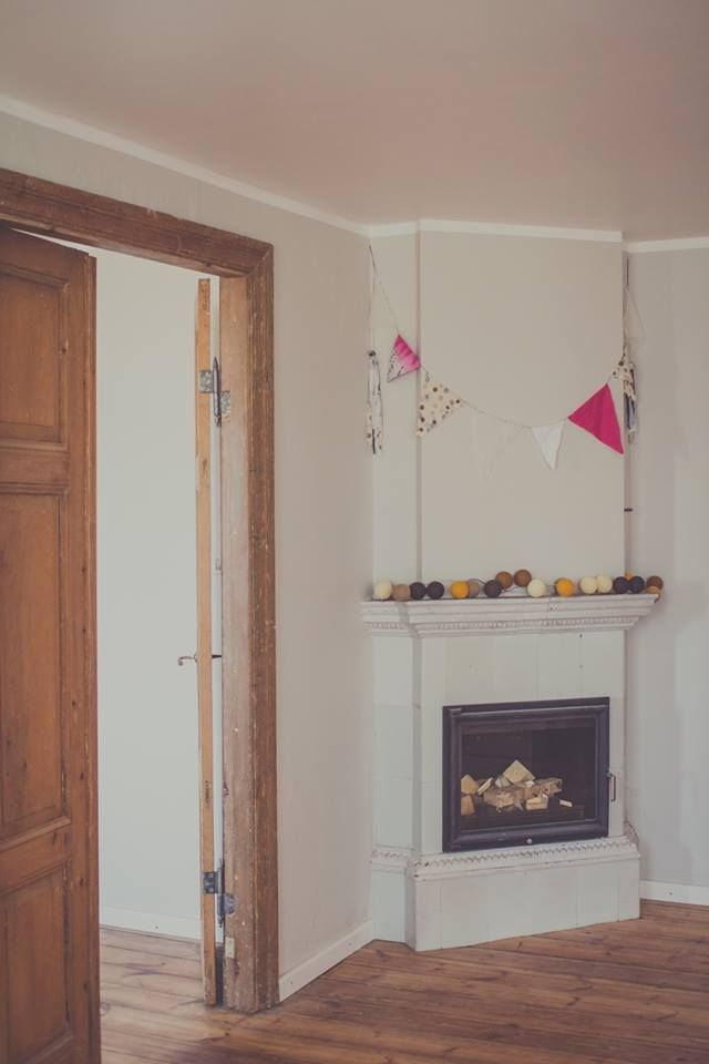 Vintage fireplace with hardwood floors and doors