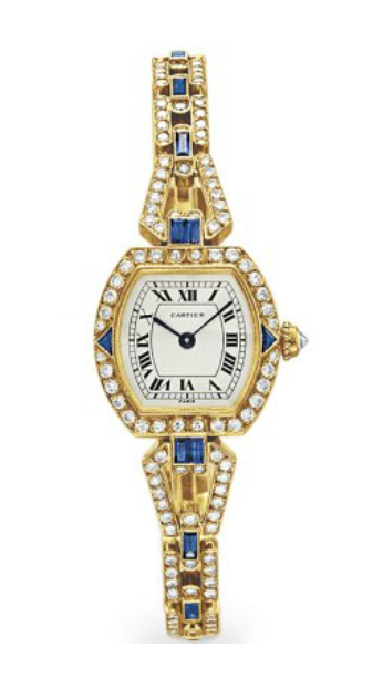 A DIAMOND, SAPPHIRE AND GOLD WRISTWATCH, BY CARTIER   With mechanical movement, 17 jewels, the tonneau-shaped dial with black Roman numerals and blued steel hands, within a circular-cut diamond bezel with triangular-cut sapphire detail and diamond-set crown, to the circular-cut diamond and rectangular-cut sapphire link bracelet, mounted in 18k gold, 6½ ins., with French assay marks and maker's mark, in a Cartier red leather box  Dial and case signed Cartier, no. 226173, movement unsigned