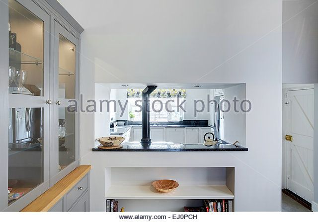 Beautiful Modern Kitchen Hatches Bread With Knife And Leaf