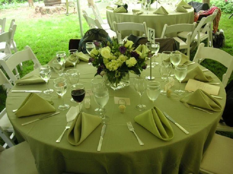 green tablecloth with green centerpieces