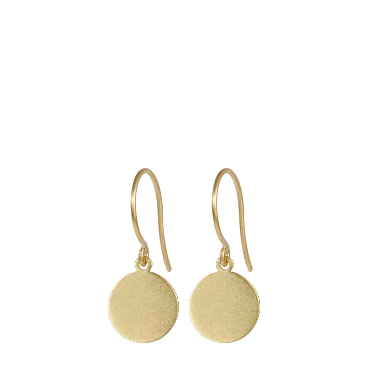 These timeless recycled 18K gold disc earrings highlight the beauty of simplicity, shimmering with a subtle matte finish while dangling delicately from your ear