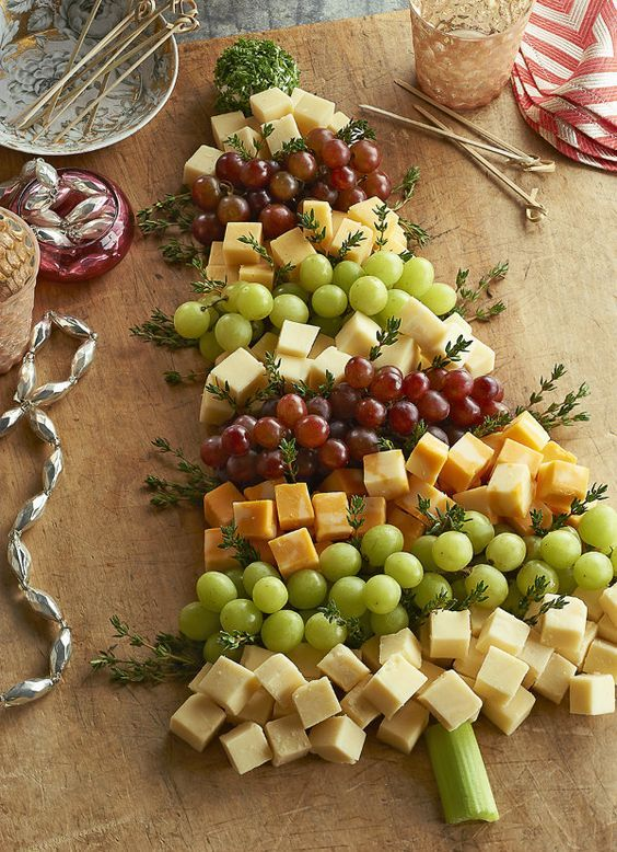 Photo of grape, thyme and cheese shaped Christmas tree appetizer add some fresh natural e…