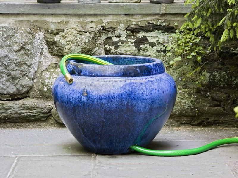 classy garden hose storage pot