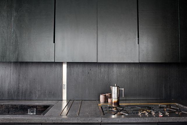 concrete counter tops w/ black cabinets