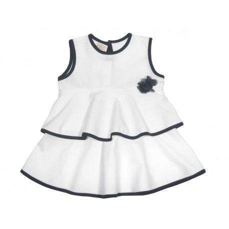 Vestido blanco de volantes de niña Marca Paz Rodríguez  Encuéntralo en www.pepaonline.com