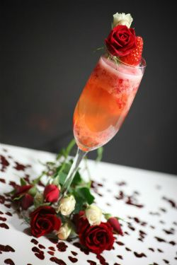 Muddled strawberries, sparkling wine, and RangTang vodka for a pretty Valentine's drink