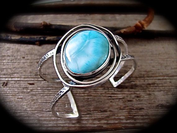 I love the simplicity of this handcrafted larimar cuff bracelet. A beautiful organic spiral surrounds the handset larimar in brilliant blue