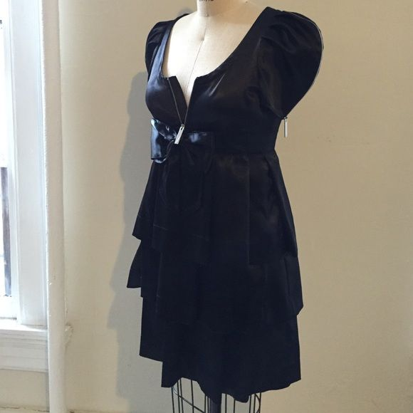 J.C.de Castelbajac black dress Gorgeous, never worn Jean Charles de Castelbajac black silk dress EUROPEAN SIZE 42. Tons of cool details. Message me for more pictures. I bought this in Paris. Has cute baby doll like bow at front. Jean Charles de Castelbajac Dresses Mini
