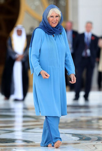 Camilla, Duchess of Cornwall fixes her scarf before she leaves the Sheikh Zayed Grand Mosque in Abu Dhabi