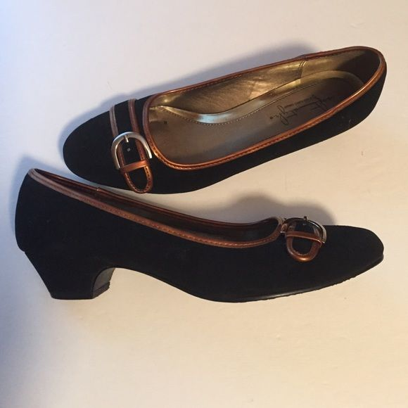 Soft style black and bronze colored shoe This is a black and bronze colored soft style shoe made by the hushpuppy company. They are a size 8 medium and are very comfortable and can be worn all day long. Great for office or evening. See photos for details. Hush Puppies Shoes Heels