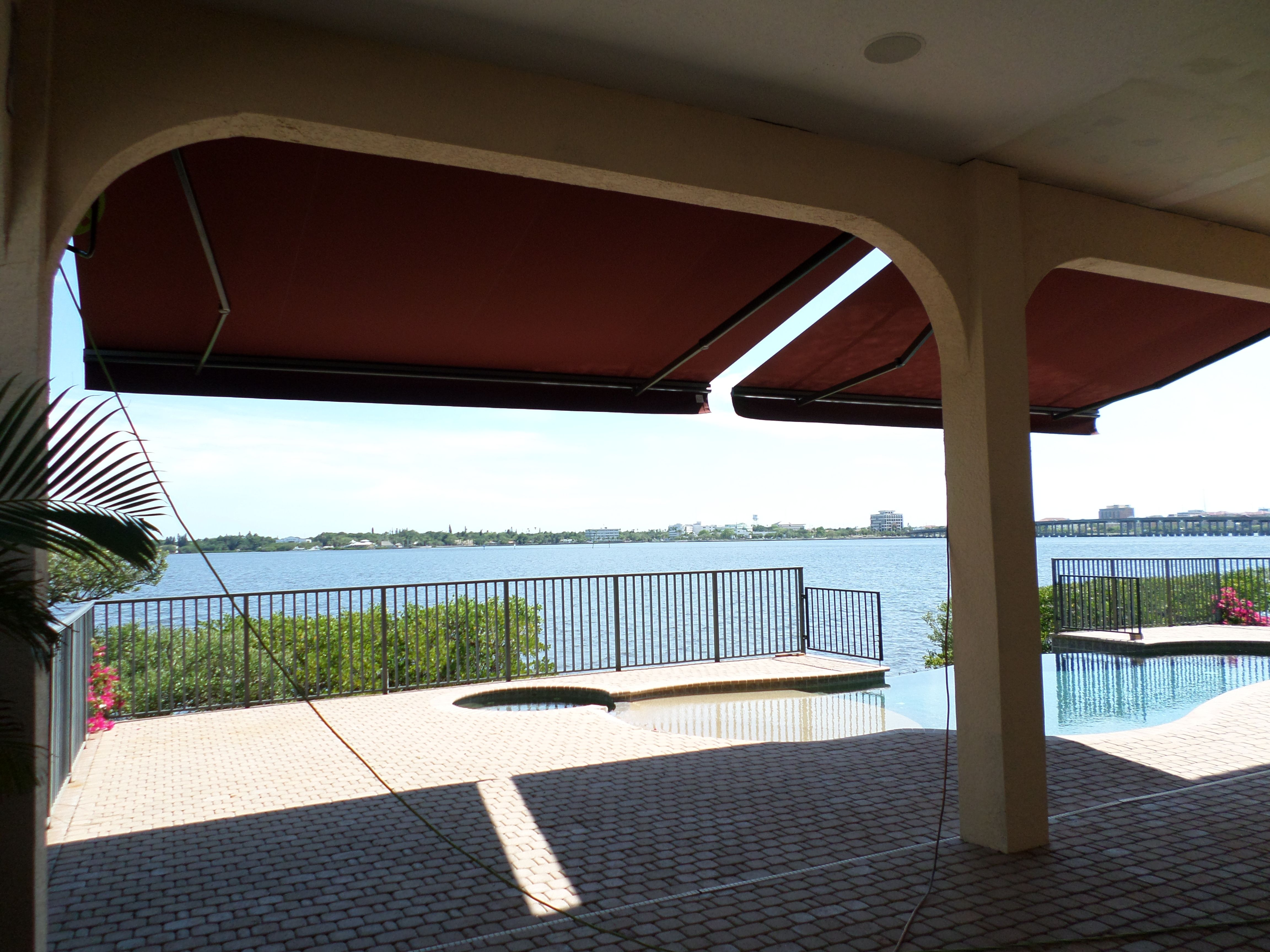 Double Retractable Awnings To Enhance The River View Awning Installation Retractable Awning Awning