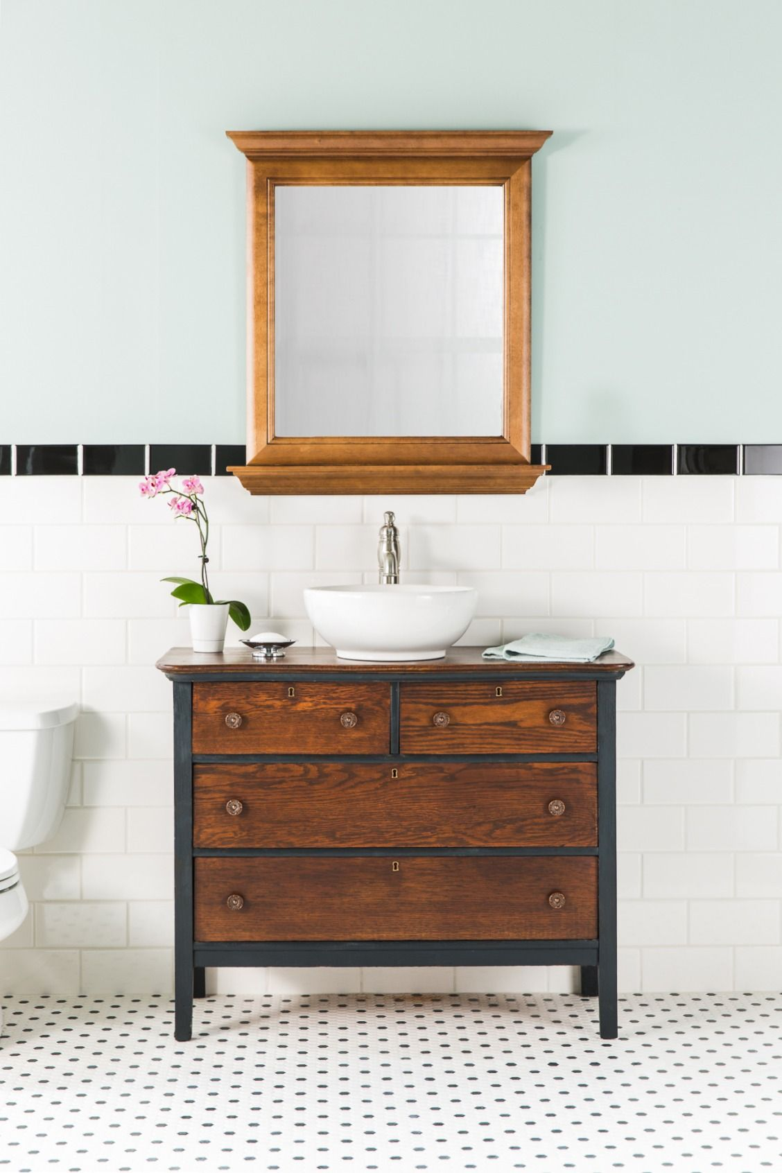 A rustic dresser transforms into a stylish bathroom vanity with the ...