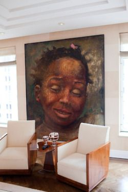 L.A. Reid's living room. I love how the big piece of art is the focal point.