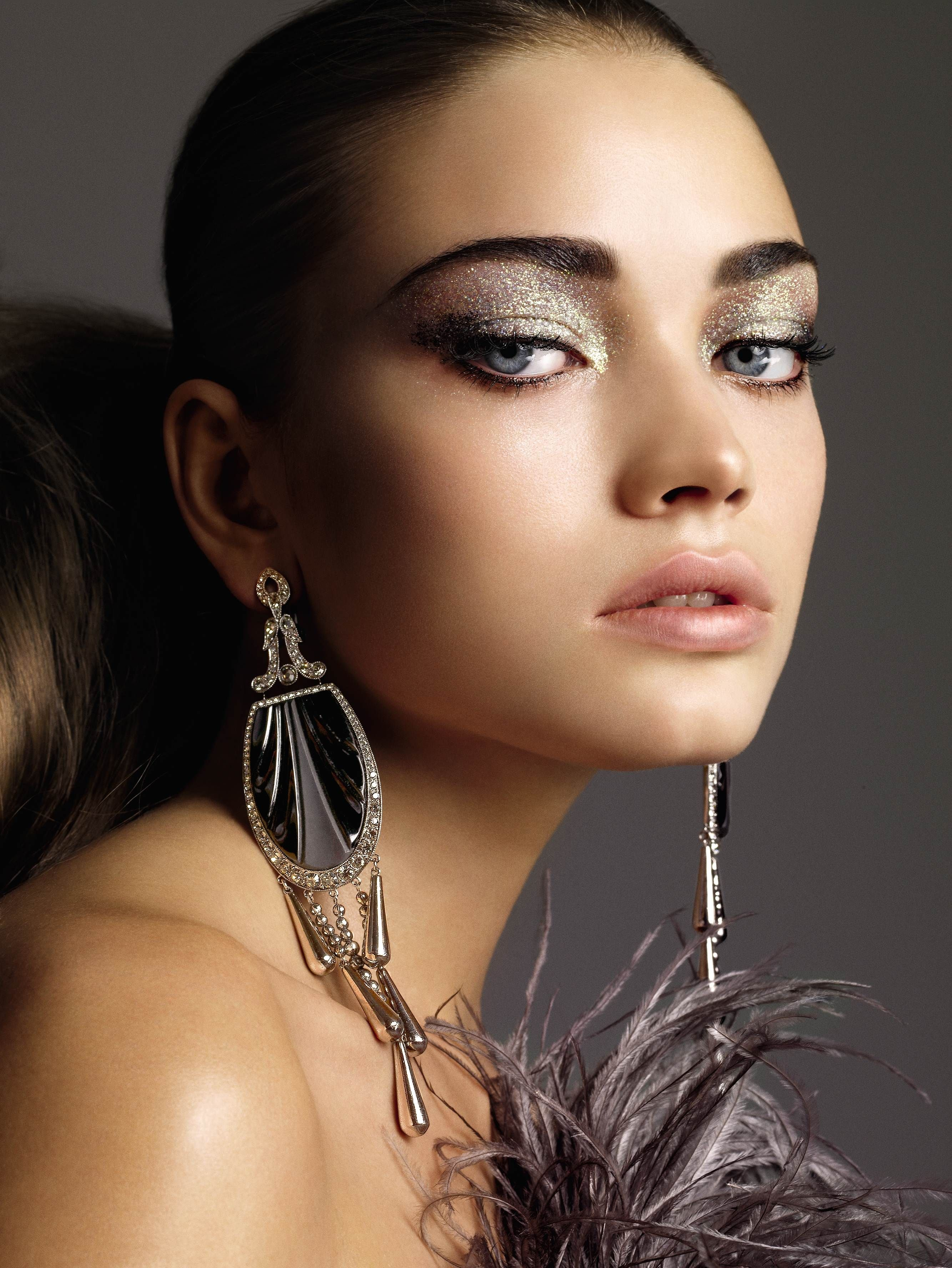 The secret to keeping sparkly shadow from looking juvenile? A little black liner. First trace the upper lids with a black pencil. Then dust a slightly shimmery shadow over the entire lid. Choose gold for warm complexions and silver or platinum for cool ones. Finish with black mascara.