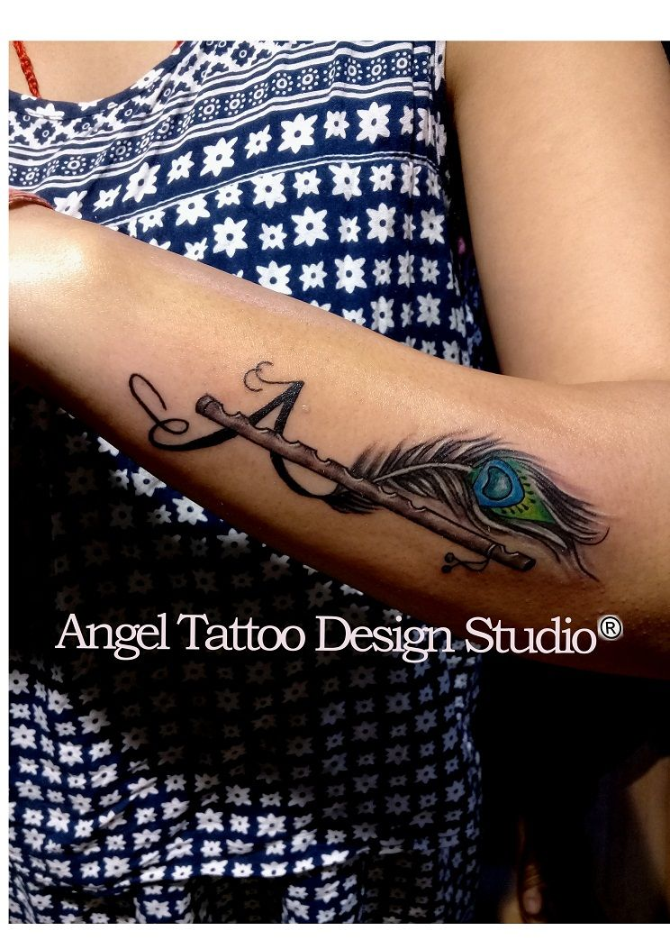 d6332f48c Letter A Tattoo made with peacock feather and flute at gurgaon shop; call  8826602967 for appointment #letterAtattoo #LetterA #letterawithflutetattoo